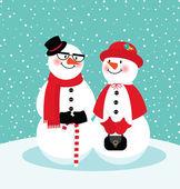 Couple of snowmen — Stock Vector