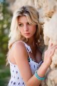 Beautiful sensual girl standing near stone wall — Stock Photo