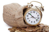Alarm clock and coins — Stock Photo