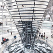 Tourists under Reichstag dome — Stock Photo #58799723