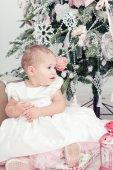 Little girl  near a Christmas fir-tree — Photo