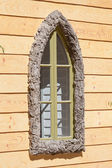Decorative window in a frame — Stock Photo