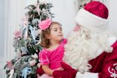 Little girl talks about something  to Santa Claus — Stock Photo