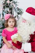 Santa Claus gives a gift to the little girl — Stock Photo