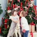 Boy and the girl near Christmas fir-tree — Stock Photo #60529997