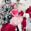 Little girl sits on a lap at Saint Nicolas — Stock Photo #60530027