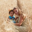 Mother with daughter in the field — Stock Photo #60530317