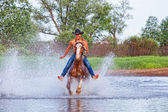 Young rider gallops — Stock Photo