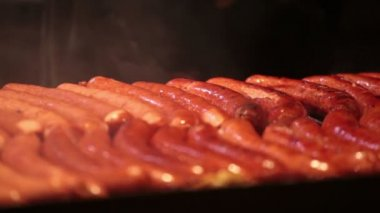 Sausages fried on grill — Wideo stockowe