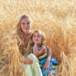 Mother with daughter in field — Stock Photo #66300747