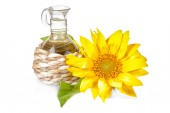 Sunflower and small bottle — Stock Photo