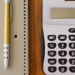Calculator and pen — Stock Photo #57832513