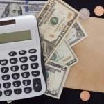 Calculator and dollars — Stock Photo #61015985