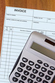 Account invoice with calculator — Stockfoto