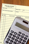 Calculator with a blank waybill — Stock Photo