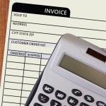 Iinvoice with a calculator — Stock Photo #63027549