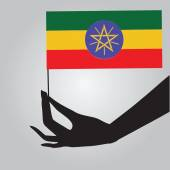 Hand with flag Ethiopia — Stock Vector