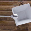 Ceramic soup square plate and spoon — Stock Photo #71819507