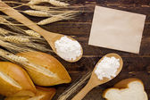 Bakery products flour in a wooden spoon — Stock Photo