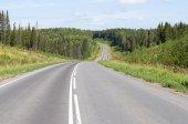 Asphalt road through the hills — Stock Photo