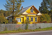 Beautiful yellow wooden house — Stockfoto
