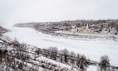 Winter dull landscape with frozen Volga River in Staritsa town — Stock Photo