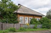 Old wooden country house with slate roof — Stock Photo