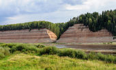 Geological outcrop on the riverbank with deep ravine — Stock Photo