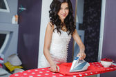 Happy young pretty woman ironing services. — Stock Photo