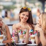 Three Women Enjoying Cup Of Coffee In Cafe. — Stock Photo #52286705