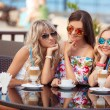 Three Women Enjoying Cup Of Coffee In Cafe. — Stock Photo #52286751