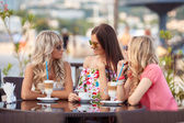 Three Women Enjoying Cup Of Coffee In Cafe. — Stock Photo