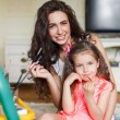Mother and daughter drawing in the room. — Stockfoto #52341167