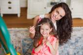Mother and daughter drawing in the room. — Stock Photo