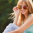 Contrast portrait of a beautiful blond in sunglasses. — Stock Photo #53309761