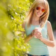 Contrast portrait of a beautiful blond in sunglasses. — Stock Photo #53309835