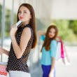 Pretty lady showing credit card in the mall — Stock Photo #54318671