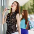 Pretty lady showing credit card in the mall — Stock Photo #54318813