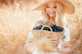 Portrait of a woman with grape in hands — Stock Photo