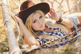 Young american cowgirl woman portrait outdoors. — Stock Photo