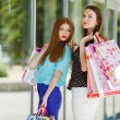 Two cute women view showcases the supermarket. — Stock Photo #57089283