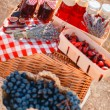 Juice, berries and lavender in a straw basket. — Stock Photo #57169749