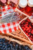 Juice, berries and lavender in a straw basket. — Stock Photo