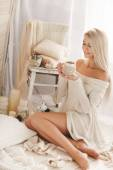 Young woman drinking coffee at home in his room. — Stock Photo