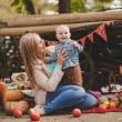 Mother and son playing in the yard of his house in the village — Stock Photo #58039587
