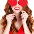 Beautiful girl in a Valentine's Day with a heart on a stick. — Stock Photo #61642747