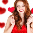 Beautiful girl in a Valentine's Day with a heart on a stick. — Stock Photo #61642793