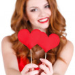Beautiful girl in a Valentine's Day with a heart on a stick. — Stock Photo #61642809