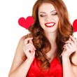 Beautiful girl in a Valentine's Day with a heart on a stick. — Stock Photo #61642857