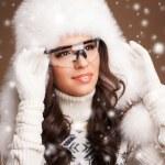 Portrait of a beautiful brunette in ski goggles. — Stock Photo #61855361